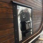 Outside wood loading heater